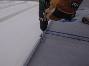 Screwing the clip to the roof decking