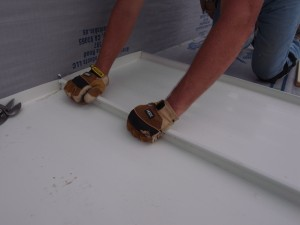 I used my hand to clamp the seams together as we pulled out the 1x2 boards