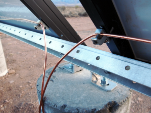Close up of grounding lugs attached to the solar panels