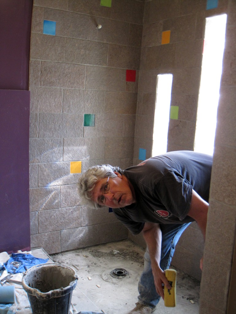 Brad hard at work (I cut most of the tile.)